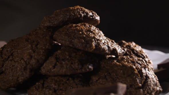 Thumbnail for Rotating Plate With Homemade Chocolate Cookies On Black Background