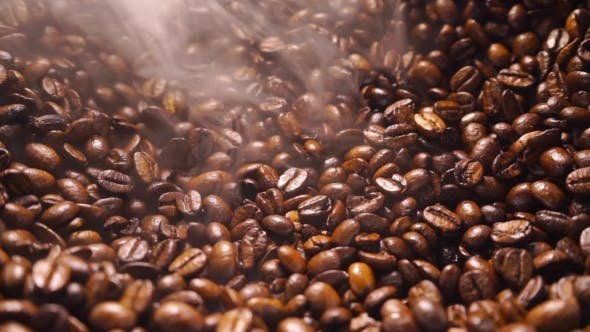 Thumbnail for A Pile Of Smoking Roasted Coffee Beans