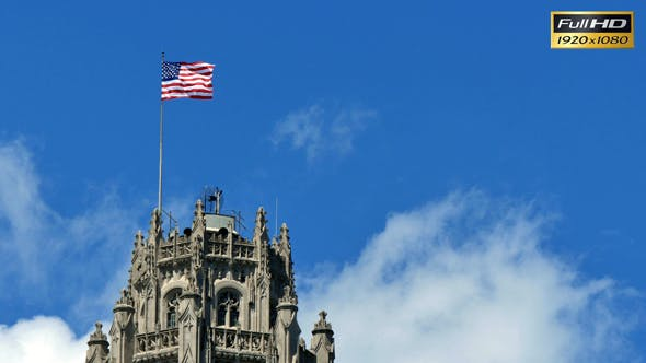 Thumbnail for United States of America Flag Waving on the Top of a Skyscraper