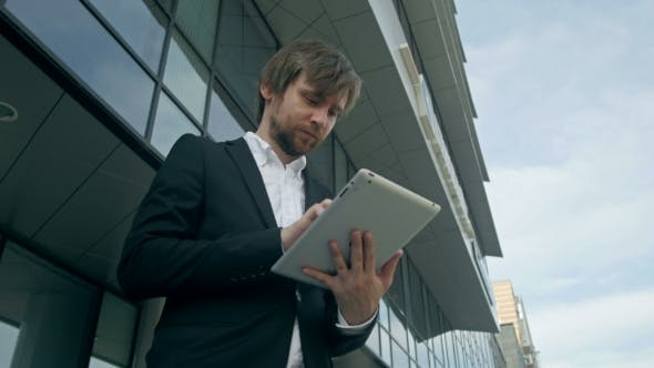 Thumbnail for Handsome Young Man With Tablet In The Streets Near Office