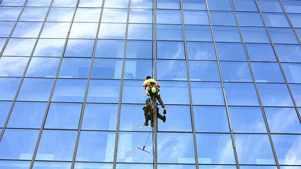 Cover Image for Man Cleaning Windows of Office Building 2