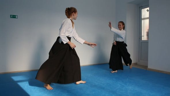 Thumbnail for Two Girls In Black Hakama Practice Aikido