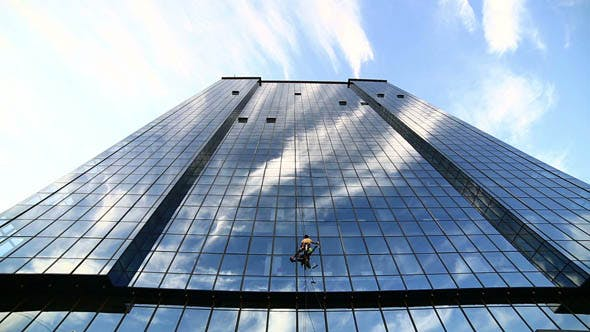 Thumbnail for Man Cleaning Windows of Office Building 3