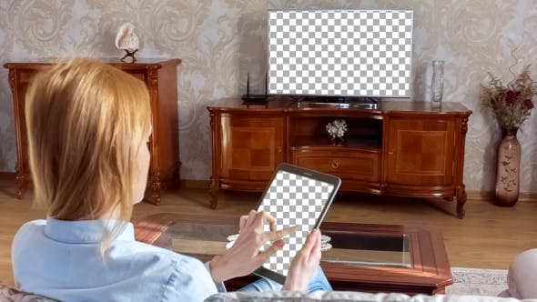 Thumbnail for Girl Using Tablet In Front Of The TV 1 With Isolated Screen