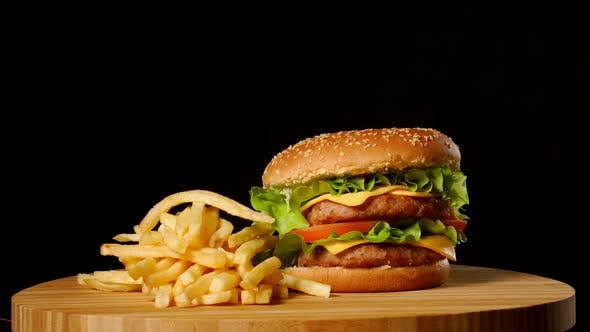 Thumbnail for Craft Beef Burger and French Fries, Sauce Isolated on Black Background. Fast Food