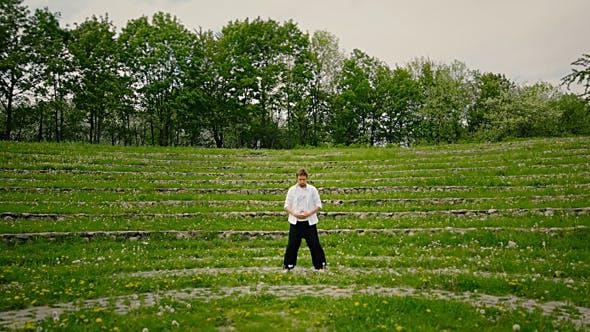 Thumbnail for Young Man Practicing Qigong