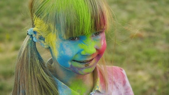 Thumbnail for Portrait Of a Cute Girl Painted In The Colors Of Holi Festival.