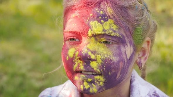 Cover Image for Portrait Of a Cute Girl Painted In The Colors Of Holi Festival.