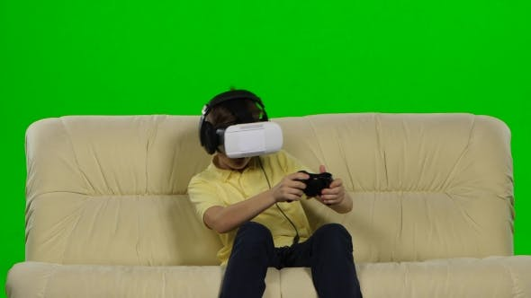 Thumbnail for Little Boy Uses Head-Mounted Display