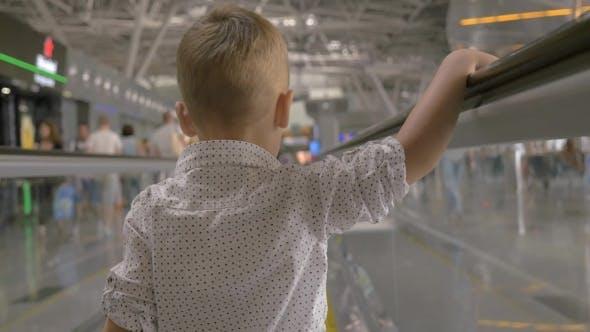 Thumbnail for Little Kid on Flat Escalator in Trade Center