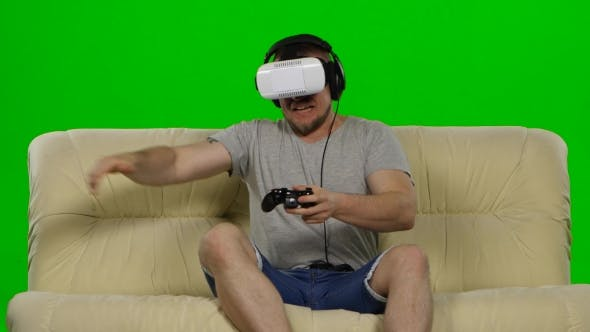 Thumbnail for Young Handsome Man On Sofa Wearing VR Headset Glasses