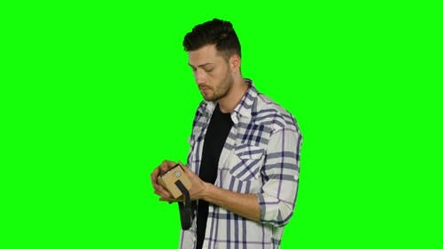 Virtual Reality Game. Boy Uses Head Mounted Display. Green Screen