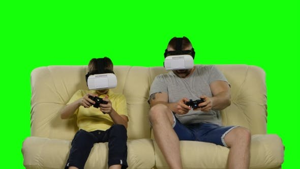 Family Weekend Game Virtual Reality. Use VR Glasses. Green Screen