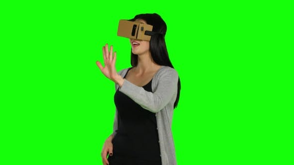 Thumbnail for Girl In Virtual Reality Is Smilling And It Makes Him Laughing. Green Screen