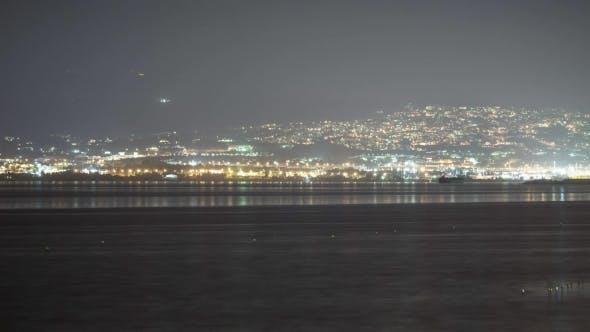 Nightlife of Distant Coastal City