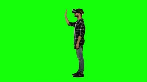 Thumbnail for Man Wearing Virtual Reality Goggles