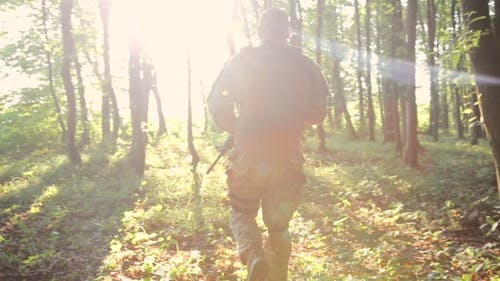 Military Goes In The Forest And Looks Back