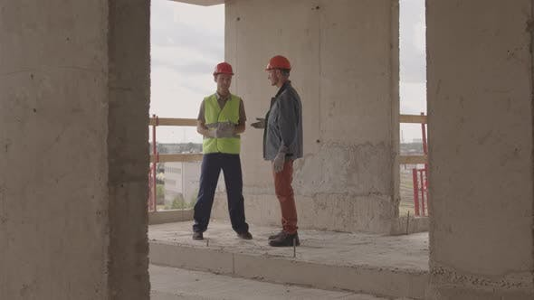 Workers Standing on Construction Site