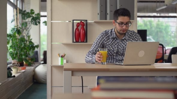 Thumbnail for Man Works In The Coworking With Laptop.