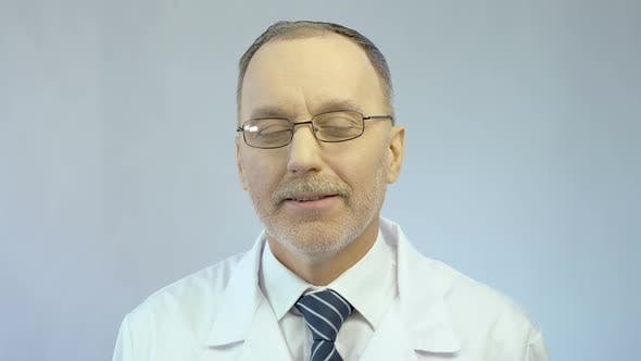 Thumbnail for Male Therapist Looking Kindly at Patient Sympathetic Smile on Face Medicine