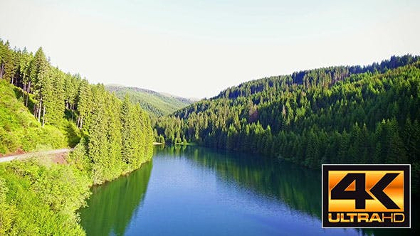 Thumbnail for Fly Over Mountain Lake In A Sunny Day
