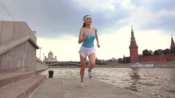 Thumbnail for Beautiful Girl Runner Against Moscow Kremlin 240 Fps