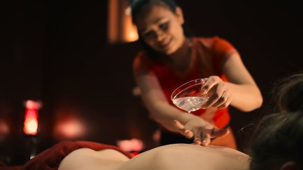 Thumbnail for Masseuse Pouring Oil Female Back.