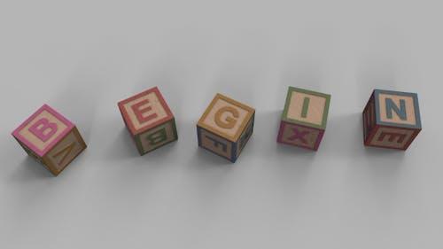 Falling Toy Bricks Make Up Different Words: Begin, Block, Brain, Class, Oldie