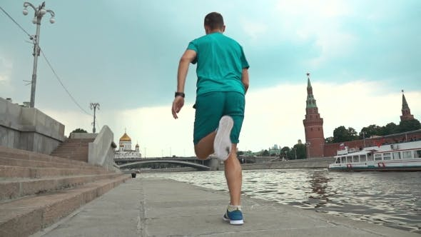 Thumbnail for Athletic Male Running Against Moscow Kremlin. Super  Steadicam Video 240 Fps