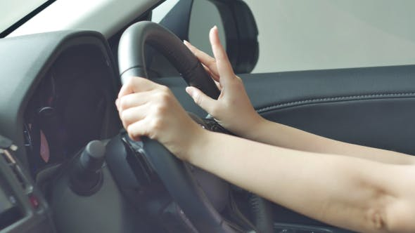 Thumbnail for Women Tapping Fingers With Music In Car