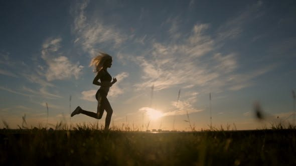 Thumbnail for Silhouette Of a Sexy Fit Woman Girl Running At Sunset. Training.