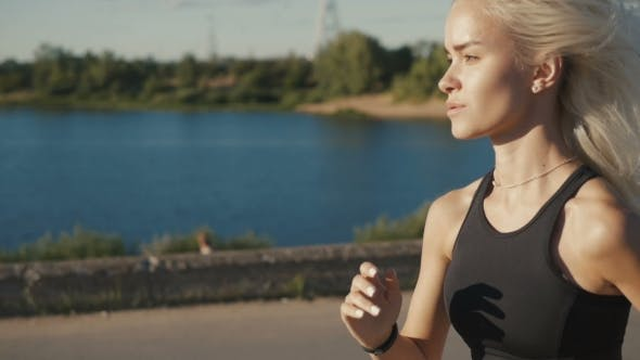 Thumbnail for Woman Running with Fitness Tracker. Sexy Sport Girl.