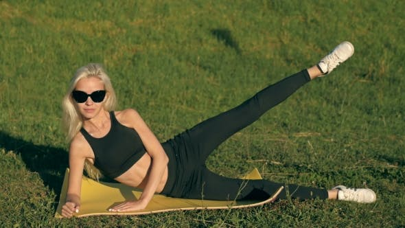 Thumbnail for Sports Sexy Blonde Girl Model Does Exercises Abdominal Workout Outdoors In Park