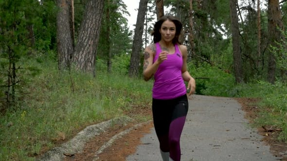 Thumbnail for Fitness Workout Outdoors. Sport Woman Running Through The Woods. .