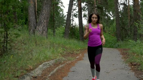 Thumbnail for Sport Workout Outdoors. Sport Woman Running Through The Woods. .