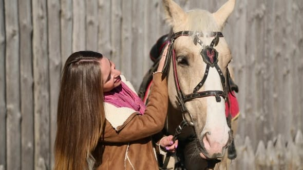 Thumbnail for Girl In The Brown Jacket Stroking Horse