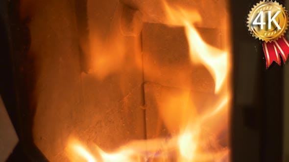 Man Opens a Door of the Metal Furnace