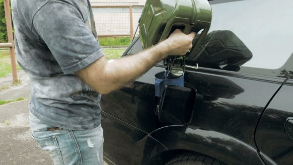 Thumbnail for Man Fuels Car From Jerry Can Petrol Gas Or Diesel