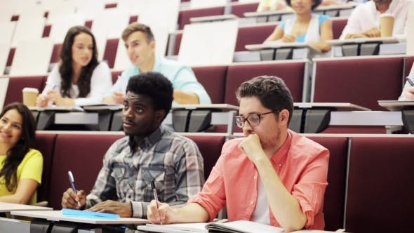 Thumbnail for Group Of Students With Notebooks In Lecture Hall
