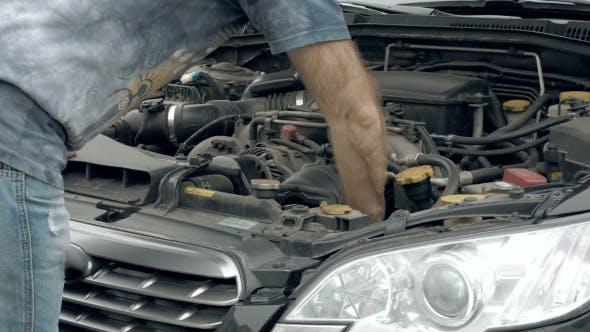 Thumbnail for Auto Mechanic Visually Examines Car Motor Engine