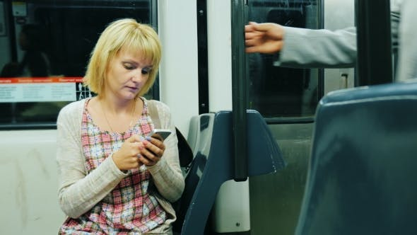 Thumbnail for Woman uses phone in Subway