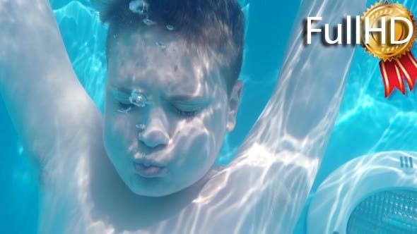 Thumbnail for Teen Boy Dives in Blue Pool With Closed Eyes and