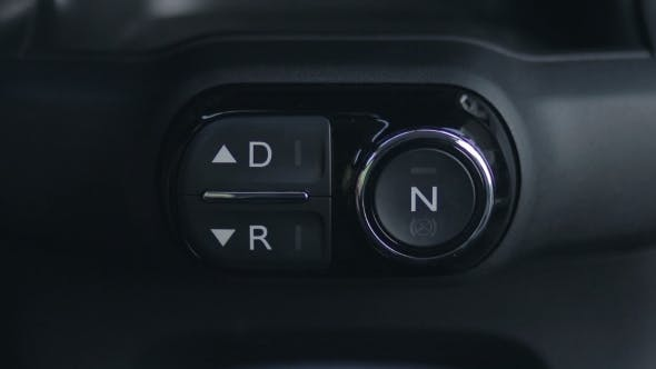 Thumbnail for Woman Hand Pushing Reverse Gear Button In Car