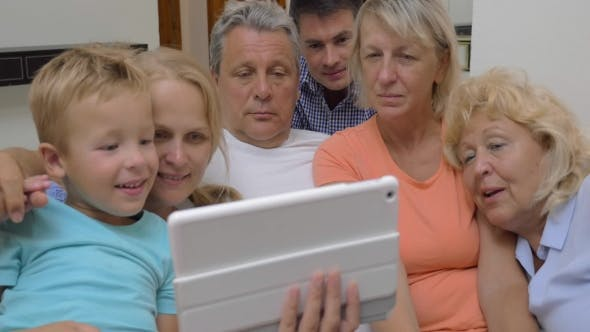 Thumbnail for Big Family With Child Watching Tablet Computer