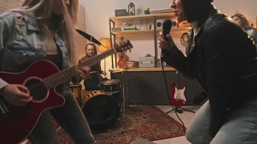 Energetic All-Girl Band Rocking Out In Studio