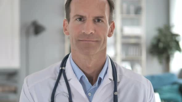 Thumbnail for Senior Doctor in Clinic Looking at Camera
