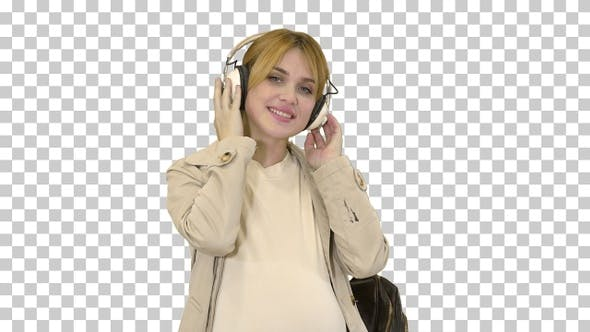 Young attractive pregnant woman listening, Alpha Channel