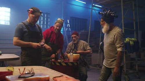 Men Making Bets and Arguing in Garage