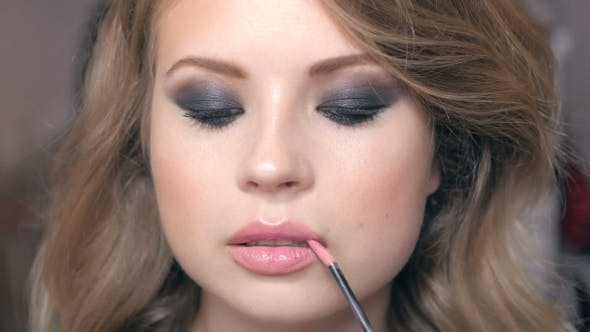 Thumbnail for Young Beautiful Woman Applying Make-up By Make-up Artist