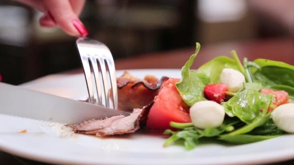 Thumbnail for Eating Salad With Fork And Knife